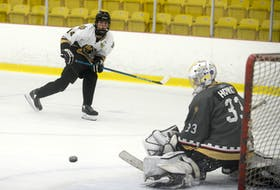 Forward Jonah MacDonald watches as goalie George Gallant makes a save on his shot during the first period of Monday's Charlottetown Bulk Carriers Knights intrasquad game. It was part of the major under-18 hockey team's identification camp at MacLauchlan Arena in Charlottetown. There are about 45 players in camp. MacDonald played for the Mount Academy Saints under-17 team in 2020-21 while Gallant played for the Prince County Warriors under-15 squad. MacDonald and his Team White teammates won 4-2 Monday in a game that consisted of two 30-minute periods. Grey led 1-0 after the first period, but White scored four times in the second period. Mike Arsenault, Caleb MacDonald, Sam Bowness and Holden Bradley scored in the win. Jonah MacDonald and Kal White each had two assists while singles went to Caleb MacDonald, Finn Morris and Cam MacLean. Landon MacKinnon stopped six of seven shots in the first period while Jack Howatt turned aside 16 of 17 shots in the second period. Colby Huggan and Matt MacDonald replied with power-play goals for Grey. Isaac Vos, Alex Campbell, Jonah Jelley and Huggan each had an assist. Gallant stopped all 20 shots he faced while Kiefer Thompson stopped 18 of 22 shots he faced.