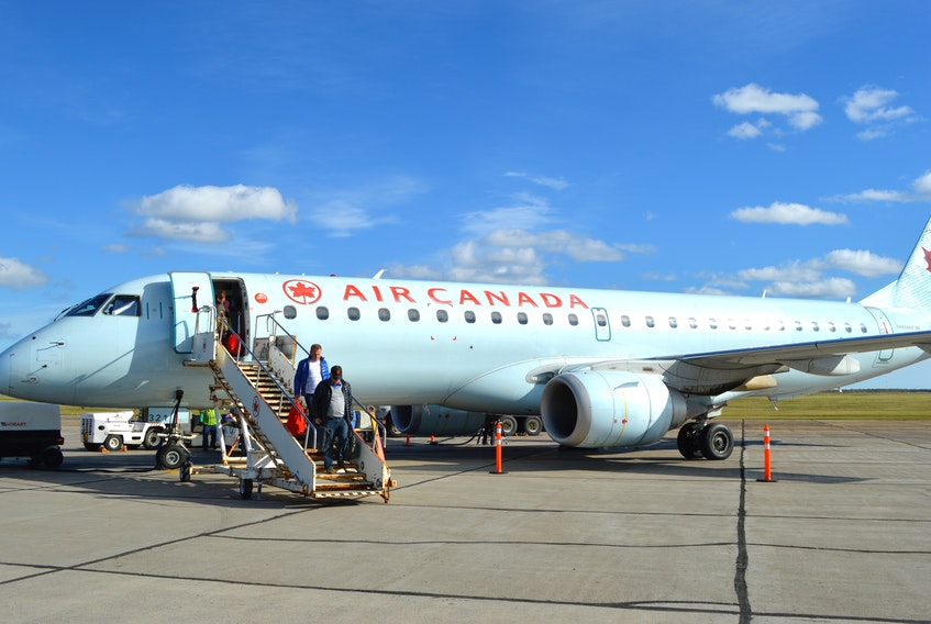 Air Canada has further delayed the resumption of its Sydney flights to and from Halifax and Montréal. Above, passengers make their way down the stairs from an Air Canada flight at the J.A. Douglas McCurdy Sydney Airport. CAPE BRETON POST FILE