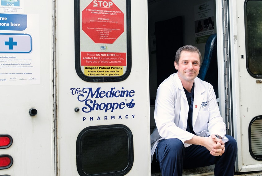 Pharmacist Michael Hatt is shown with his mobile clinic that he converted from a retired ambulance. Hatt is using it as a vaccination clinic in Port Hawkesbury but last fall, he drove it to rural communities where he offered flu shots to people who would normally have a problem getting them. STEVE RANKIN PHOTOGRAPHY