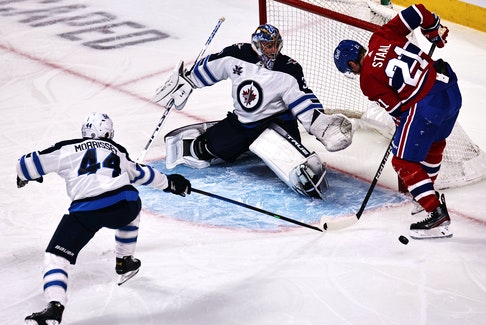 Winnipeg Jets goalie Connor Hellebuyck — shown making a save against Montreal Canadiens' Eric Staal (21) earlier this season — was once a familiar face to St. John's hockey fans. He was an AHL all-star during his last year as a St. John's IceCap. The Jets face the Canadiens in Game 1 NHL's North Division final  tonight. USA TODAY Sports File photo