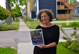 """Ann Wheatley of the Cooper Institute holds a copy of the newly published report, Safe at Work, Unsafe at Home. The report shows that temporary foreign workers in P.E.I. face crowded and unsafe housing conditions and documents """"unscrupulous"""" practices by local employers."""