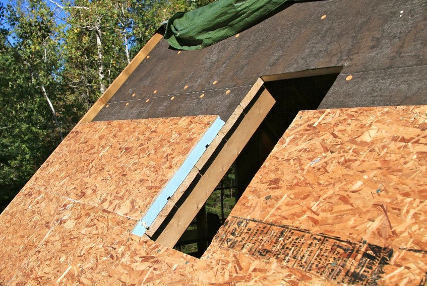 This roof is being insulated from the top using rigid sheets of extruded polystyrene foam. It allows the roof boards and rafters to remain visible from inside when maximum insulation levels are not needed.