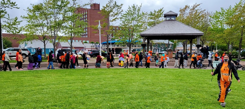 Hundreds of supporters came to Confederation Landing on Thursday to listen to the Mi'kmaq community and learn from their experiences with residential schools. - Logan MacLean