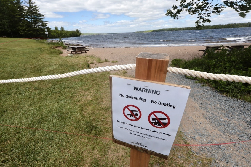 A warning sign and a red fire tape can be seen by the waterfront along Grand Lake last week. - ERIC WYNNE/CHRONICLE HERALD