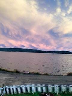 """Pat Parsons of Gander, N.L. is a rug hooker. She takes photos of the wild sky and tries to replicate the images with dyed wool of the same colours on her hooked rugs. She took this photo of Clay Cove in Eastport, N.L. She said, """"This sky would be a challenge to hook, but oh what fun to try."""" Thanks, Pat, for sending this photo."""