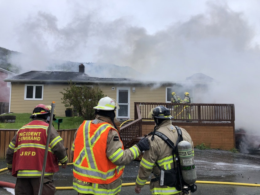 Members of the St. John's Regional Fire Department battle a structure fire on Harding's Hill in Portugal Cove-St. Philip's on June 10. - Joe Gibbons