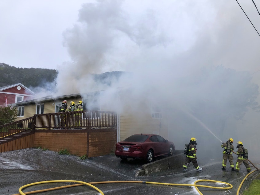 Firefighters tackle a house fire on Harding's Hill in Portugal Cove-St. Philip's on Thursday, June 10. - Joe  Gibbons