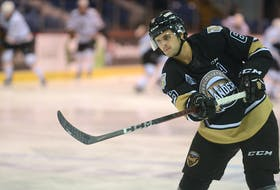 Charlottetown Islanders defenceman Noah Laaouan warms up the goalie before a Quebec Major Junior Hockey League game in the 2020-21 regular season.