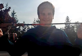 Lucas Harris with the new rod and reel outfit that he received from Matt Dort.