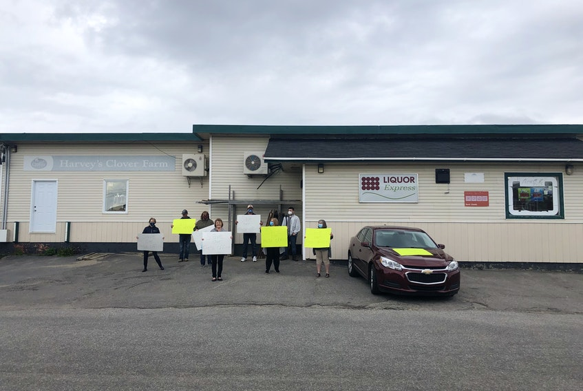 Protesters blocked a Canada Post employee from removing mail from the postal outlet at Harvey's Grocery and Confectionary in Burnt Islands on Thursday. Canada Post had announced it was closing the outlet, but later reached an agreement with the owners of the store to keep it open.