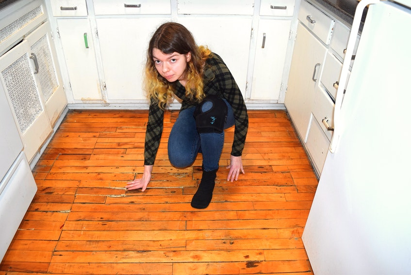 Hailey O'Day in her Townsend Street, Sydney apartment which she says is infested by mice. Sharon Montgomery-Dupe • Cape Breton Post.i