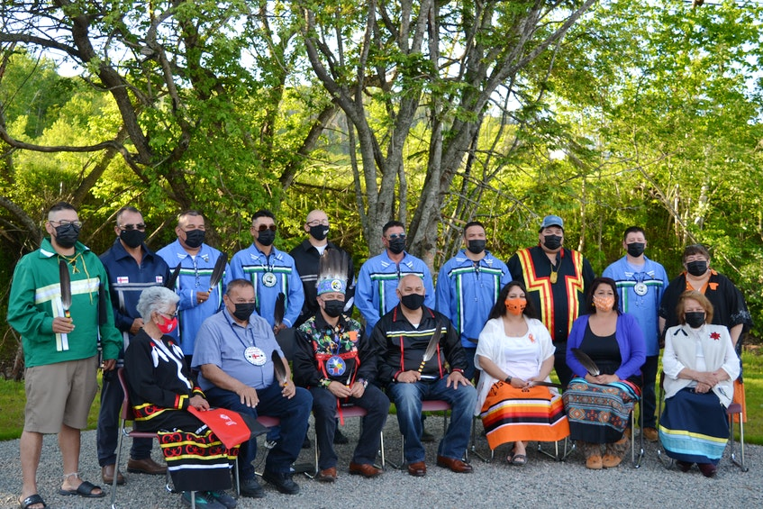 Newly sworn-in chief and council, along with community elders and officials, took part in the inauguration event on Wednesday evening. Pictured from left to right, front row: Elder Georgina Doucette, Grand Chief Norman Sylliboy Sr., Chief Leroy Denny, Bertram Muin Bernard, Sophia Basque-Denny, Starr Paul, elder Lottie Johnson, and back row: Pierre Gould, John F. Toney, Leon Denny, Chris Stevens, Blair Joef Bernard, Dereck Johnson, Tom Johnson Jr., Duma Bernard, Eldon Gould, and electoral officer Melinda Young. ARDELLE REYNOLDS/CAPE BRETON POST