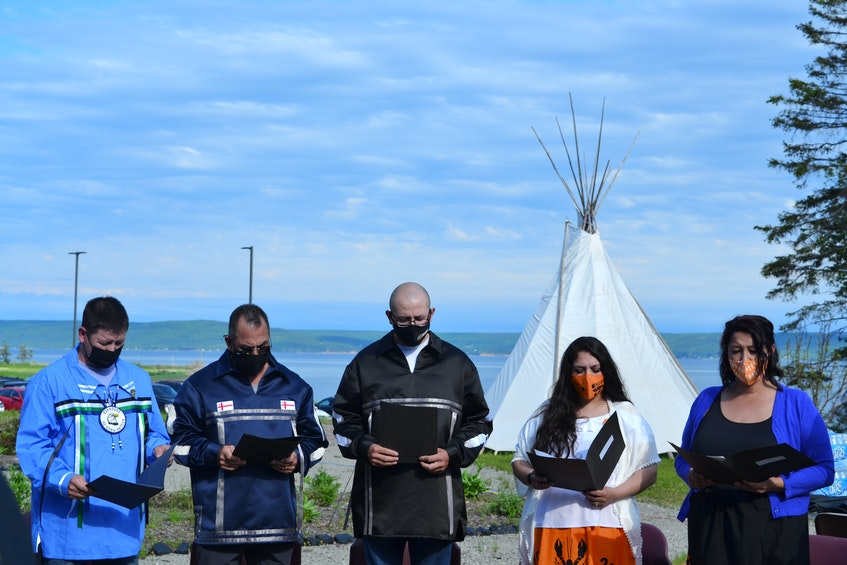 Eskasoni First Nation councillors recite their oath of office in Mi'kmaw during the inauguration ceremony on Wednesday evening outside of the Eskasoni Health Centre. ARDELLE REYNOLDS/CAPE BRETON POST