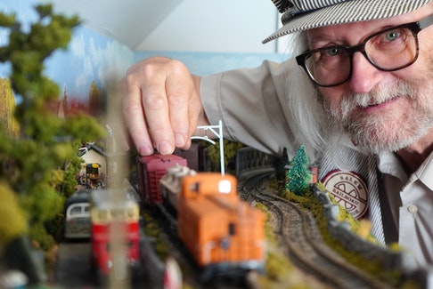 Tim Mears, an avid model railroader, showcases a section of the Sorry Valley Railway at his Murray River home in June. Daniel Brown • The Guardian