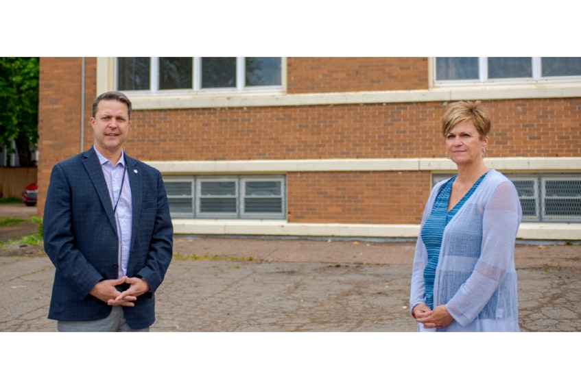 The centre will operate as usual from 8 a.m. to 8 p.m., seven days a week, and will offer financial assistance, counselling, employment, food and housing, said province officials. From left, Brad Trivers, minister of social development and housing, and Donna Keenan, reaching home co-ordinator for the John Howard Society.