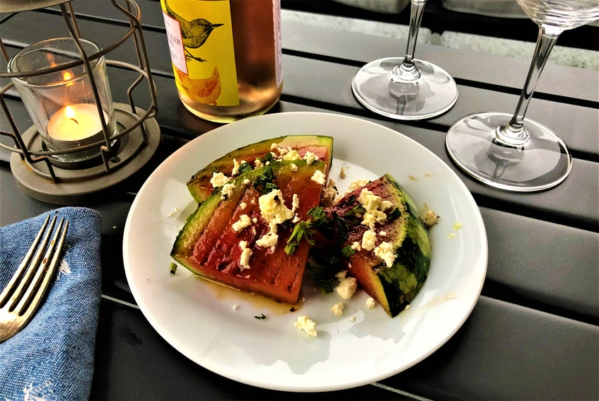 Grilled watermelon salad topped with feta and mint. - Mark DeWolf
