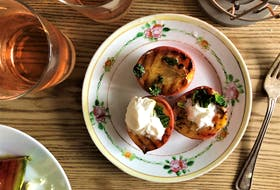 Butter and honey-basted grilled peaches make for a light, refreshing summer dessert.