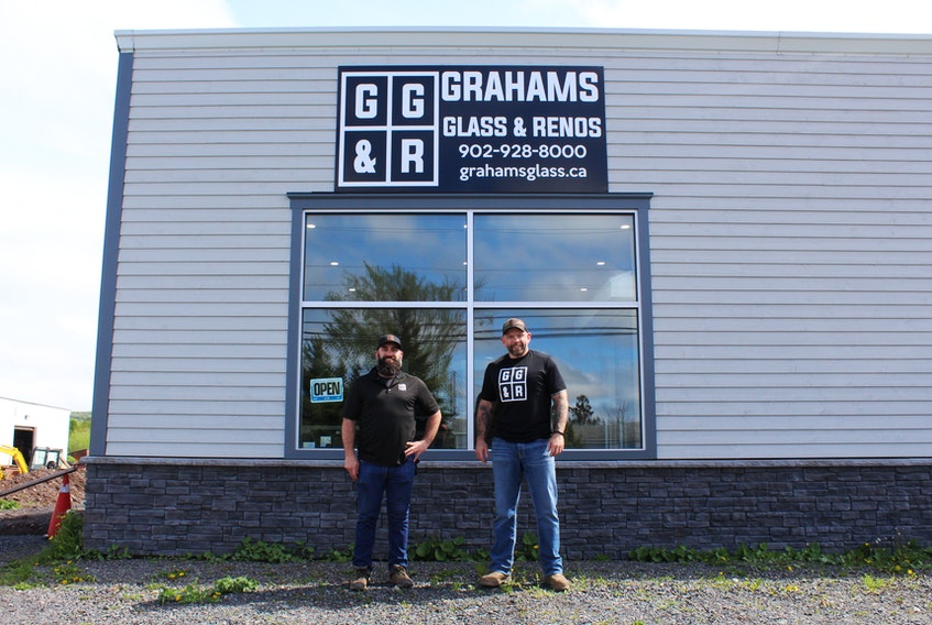 Manager Paul Bates (left) and owner Graham Hayden (right) outside Graham's Glass & Renos in Stellarton, which recently opened a retail office and showroom.