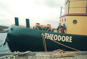 The author's family aboard Theodore Too at Snyder's Shipyard in 2000.