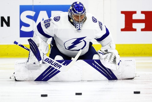 Tampa Bay Lightning goaltender Andrei Vasilevskiy stretches ahead of Game 5 against the Carolina Hurricanes on Tuesday. With a 29-save, 2-0 win, he became the first goaltender in NHL history to string together three consecutive series clinching shutouts.
