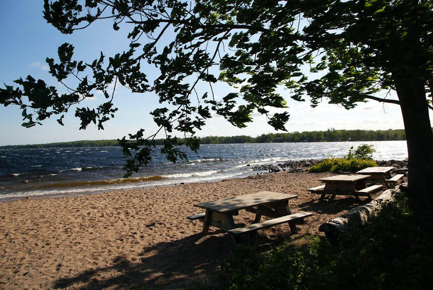 FOR NEWS STORY: Empty picnic tables areseen on the beach at Oakfield Park in Grand Lake....the lake is now closed to all boating, fishing, swimming etc....for CAMPBELL STORY.