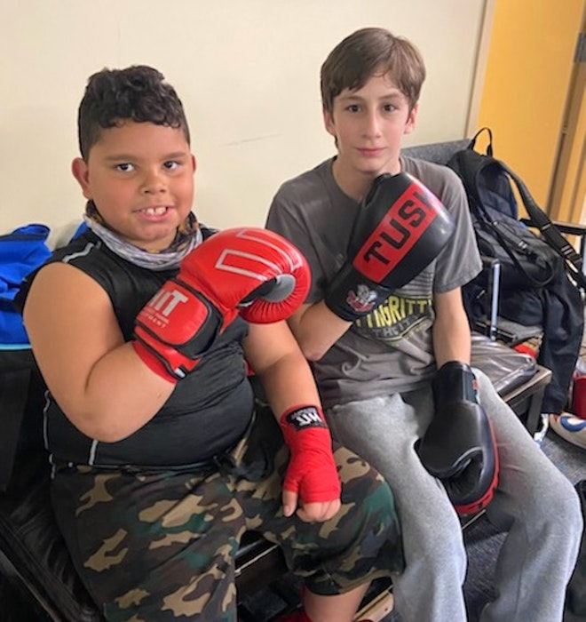Spencer McGee is one of many fellow fighters at Beyond Boxing who have taken Kingston McCrae under their wing and have helped him develop as a boxer. - Contributed