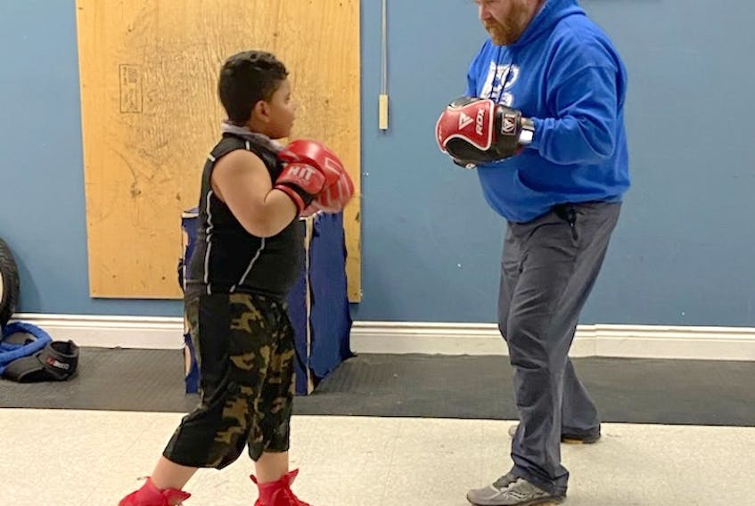 Beyond Boxing head coach Ted Ash works with Kingston McCrae during a recent training session at the Truro boxing club. Since joining the club in December, Kingston has learned valuable life lessons and skills that extend far beyond the gym.