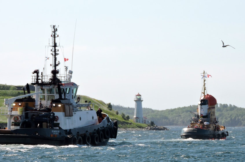 Theodore TOO, the live-size replica of TV's Theodore Tugboat, sails past George's Island in Halifax Harbour as he begins his journey to a new port of call on Lake Ontario. - Stephen Cooke