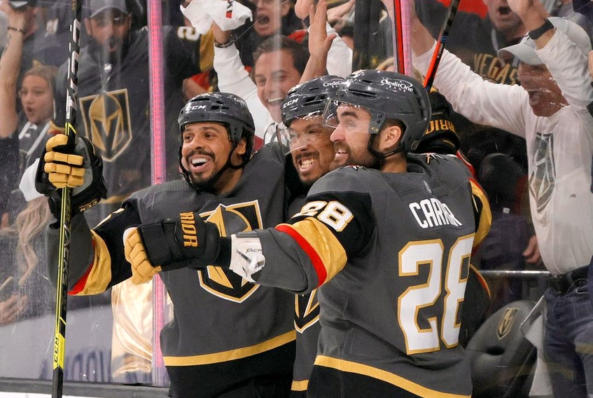 The Vegas Golden Knights' Ryan Reaves (75), Keegan Kolesar (55) and William Carrier (28) celebrate after Kolesar's second-period goal in Game 6 of West Division final against the Colorado Avalanche on Thursday night.
