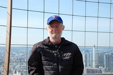 Doug McGee, former associate editor of the Cape Breton Post, travelled with his wife upon retirement. This photo was taken atop the Effiel Tower in Paris in April 2015. McGee died Friday at age 71.