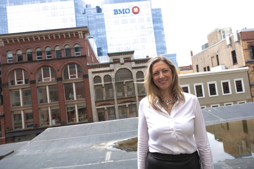 Dr. Lisa Barrett joined columnist John DeMont for an interview on the roof of an office building on Barrington Street in Halifax. - Eric Wynne