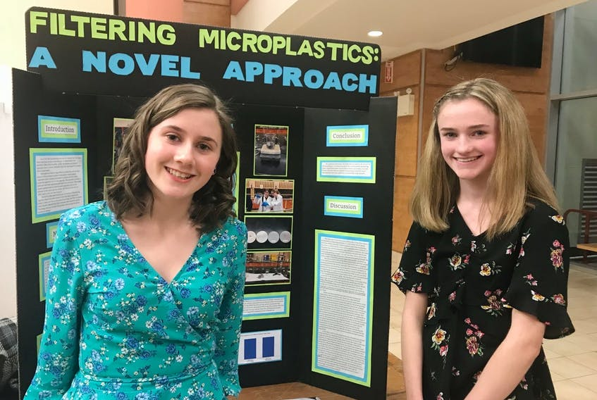 Mary MacInnis, right, and her science fair partner Julia Jamael, beside their science fair project in grade 10. MacInnis was one of 100 students across Canada to be awarded a 2021 Schulich Leaders Scholarship. CONTRIBUTED