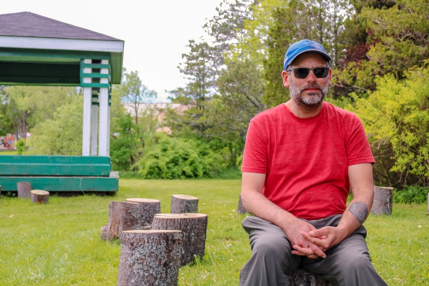 Wayne McKay, president of the Southend Public Garden Society, sits at the Collective Bees space, a collection of tree stumps that will include a fire pit in the future for group storytelling. JESSICA SMITH/CAPE BRETON POST - Jessica Smith