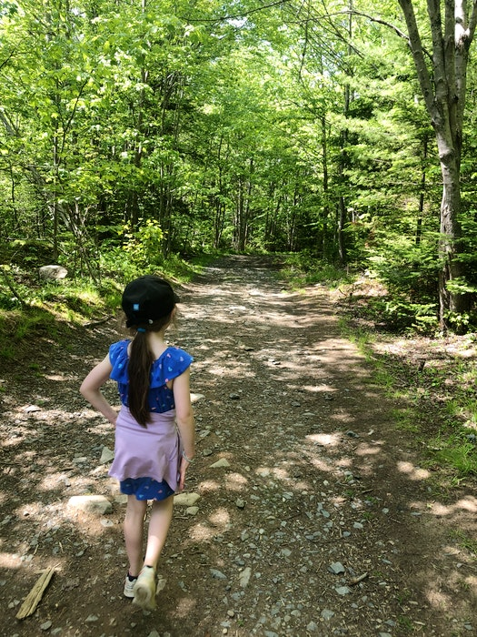 Anna Fegan walks down one of the forested paths at Sandy Lake. - Heather Fegan