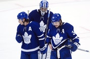 Maple Leafs' Auston Matthews (34), Mitchell Marner (16) and Jack Campbell skate off in dejection after being eliminated by the Montreal Canadiens, in Toronto on Monday, May 31, 2021. (Nathan Denette, The Canadian Press)