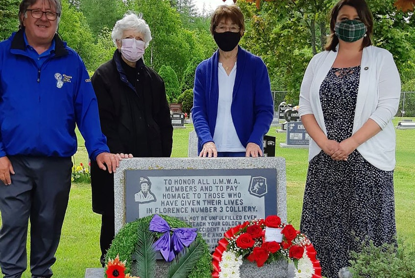 Cecil Snow of the Florence Legion, Eileen Romeo and her sister Evelyn MacDougall with Councillor Earlene MacMullin.  Eileen and Evelyn lost their father in 1947 to a mining accident in the community and have been organizing a memorial at this site in Florence for the past 22 years.