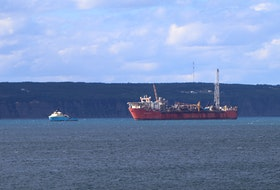 The Terra Nova floating production, storage and offloading (FPSO) vessel in Conception Bay with a supply ship. Telegram file photo
