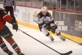 Charlottetown Islanders defenceman Lukas Cormier plays the puck during a 2020-21 regular-season game against the Halifax Mooseheads.