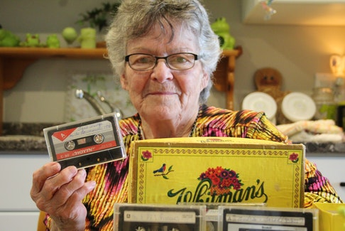 Marie Sonier holds a tape containing her father playing songs on the harmonica. The tape was one she got for Christmas six months after his death in 1981, but never listened to before it was lost.