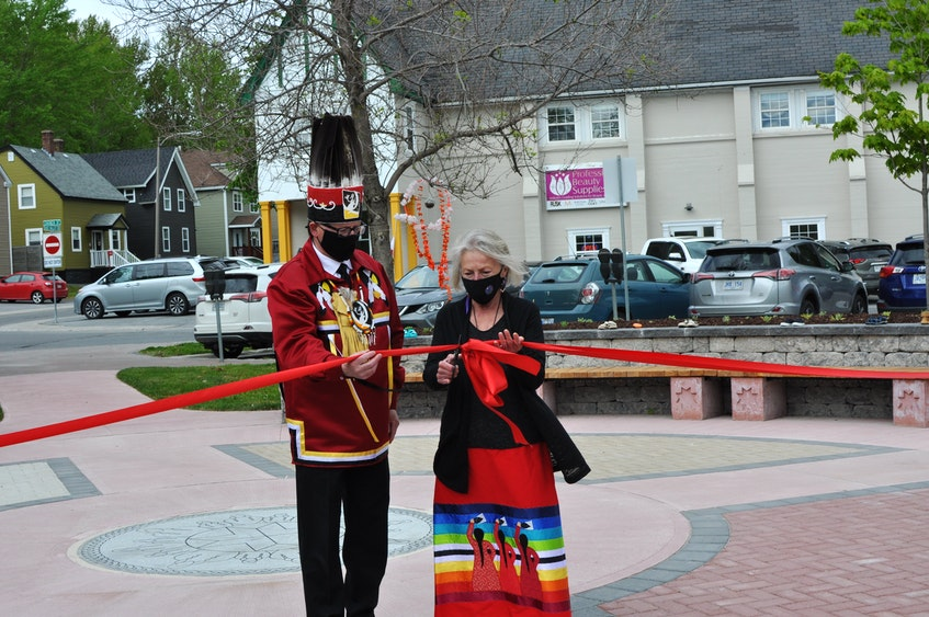 Qalipu First Nation Chief Brendan Mitchell (left) and Glenda Buckle cut the ribbon to official open the Mikwite'tm Garden on the Majestic Lawn in Corner Brook on Friday afternoon. The garden is in honour of Missing and Murdered Indigenous Women and Girls — women such as Buckle's sister, Janet Louvelle, who was murdered in 1979. — Diane Crocker