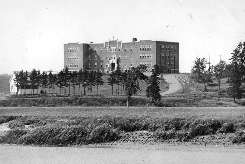 The Shubenacadie residential school opened in 1930 and was closed in 1967. Work began over the weekend to locate possible gravesites on the site of the former residential school, which is now occupied by a plastic manufacturing company. FILE PHOTO