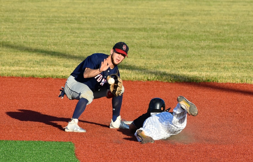 In this August 2018 file photo, Chris Farrow, left, of the Sydney Sooners prepares to slap a tag on Chris Thibideau of the Dartmouth Moosehead Dry as he tries to steal second base during a Nova Scotia Senior Baseball League game at the Susan McEachern Memorial Ball Park in Sydney. Thibideau will continue his baseball career at the professional level in Quebec in 2021. JEREMY FRASER/CAPE BRTON POST. - Jeremy Fraser
