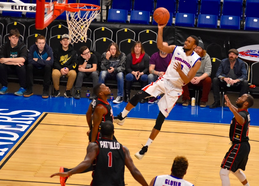 Jamal Reynolds of the Cape Breton Highlanders appears to defy gravity as he soars toward the hoop during a National Basketball League of Canada game last January against the Windsor Express at Centre 200 in 2019. Reynolds will continue his professional basketball career with the Fraser Valley Bandits of the Canadian Elite Basketball League in 2021. DAVID JALA/CAPE BRETON POST. - David Jala
