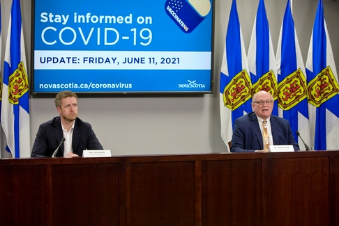Nova Scotia Premier Iain Rankin and Dr. Robert Strang, chief medical officer of health, speak at a news briefing on June 11, 2021, in Halifax.