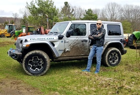 David Booth poses with the 2022 Jeep Wrangler Unlimited Rubicon 4xe. Postmedia News