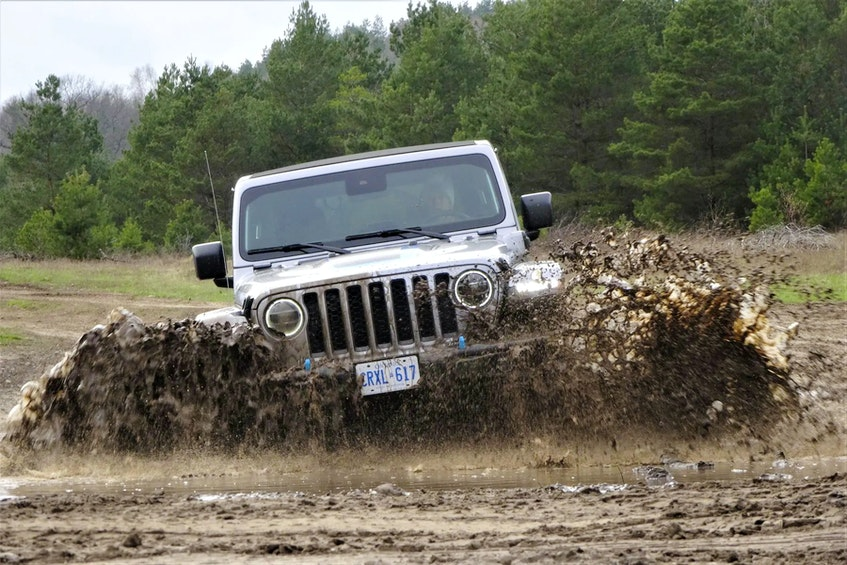 The 2022 Jeep Wrangler Unlimited Rubicon 4xe can ford 30 inches of water, despite having two electric motors. Postmedia News - POSTMEDIA
