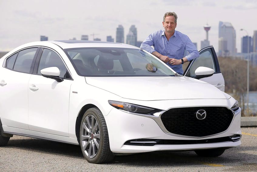 Brian Smith with the 2021 Mazda3 100th Anniversary Edition he drove in and around Calgary for a week.  Darren Makowichuk/Postmedia News