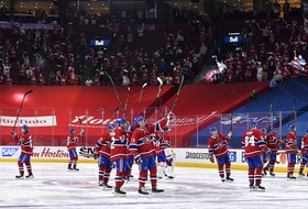 Canadiens players salute the fans following their 3-2 overtime victory against the Jets to close out the North Division series on Monday.