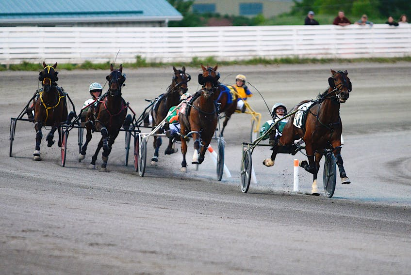 Time To Dance with Marc Campbell driving leads the pack to the finish line in the feature race at Red Shores at the Charlottetown Driving Park on Saturday, June 12.