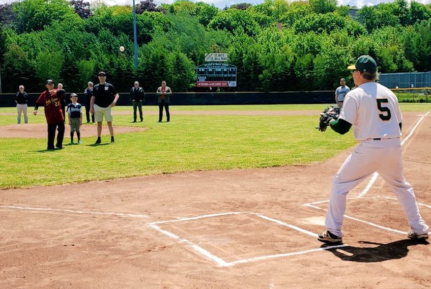 Jack Janes, who played with the 1947 Holy Cross Crusaders, winners of the very first St. John's senior baseball championship, throws out the opening pitch of the 2021 St. John's Amateur Baseball Association 2021 season Saturday at St. Pat's Ball Park in St. John's. Catching the throw from Janes is senior-league legend Peter Cornick (5) of the defending champion Shamrocks, who won the St. John's senior season-opener, defeating the Gonzaga RMM Vikings 8-1 in a rematch of the last league championship final.  — Twitter/SJABA